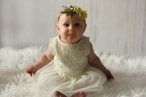 Baby lying on rug smiling baby photography in your home