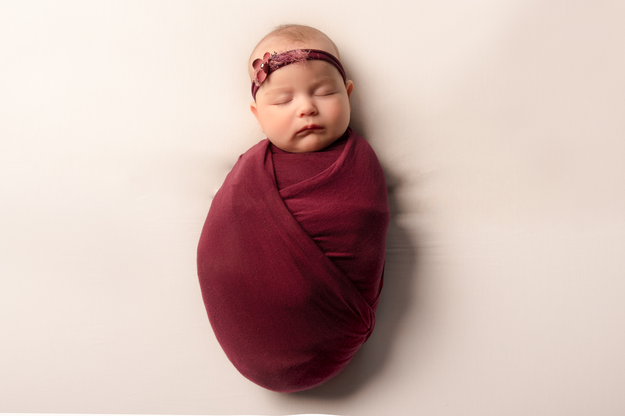 SNUG BABY GIRL WRAPPED NEWBORN PHOTO